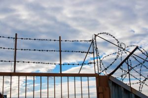 stockvault-barbed-wire-fence1384751
